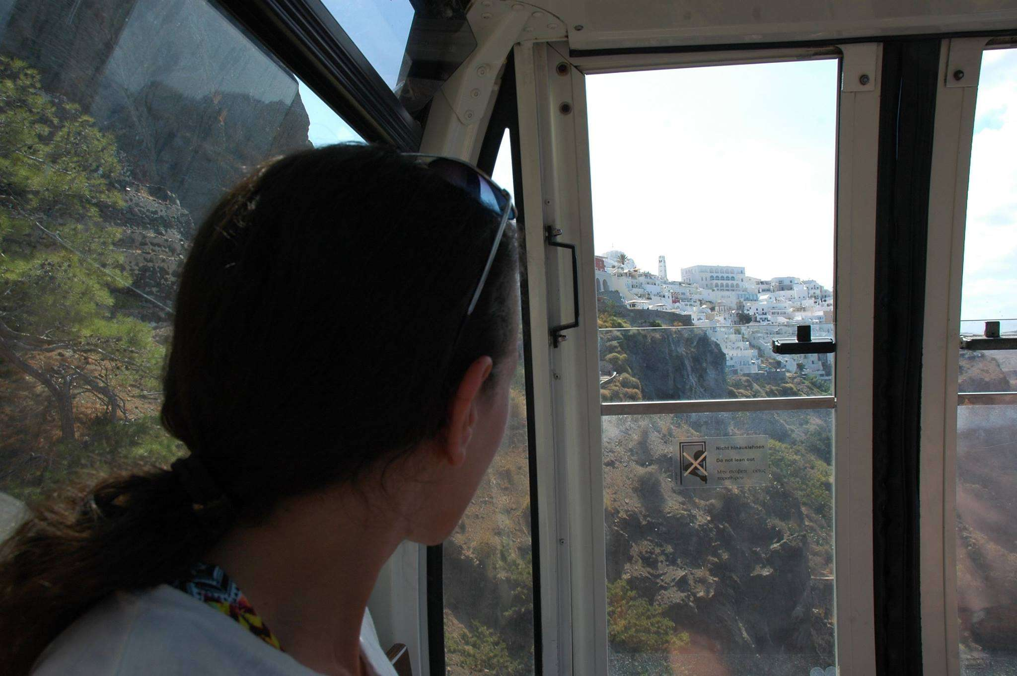 Riding the cable car in Fira, Santorini