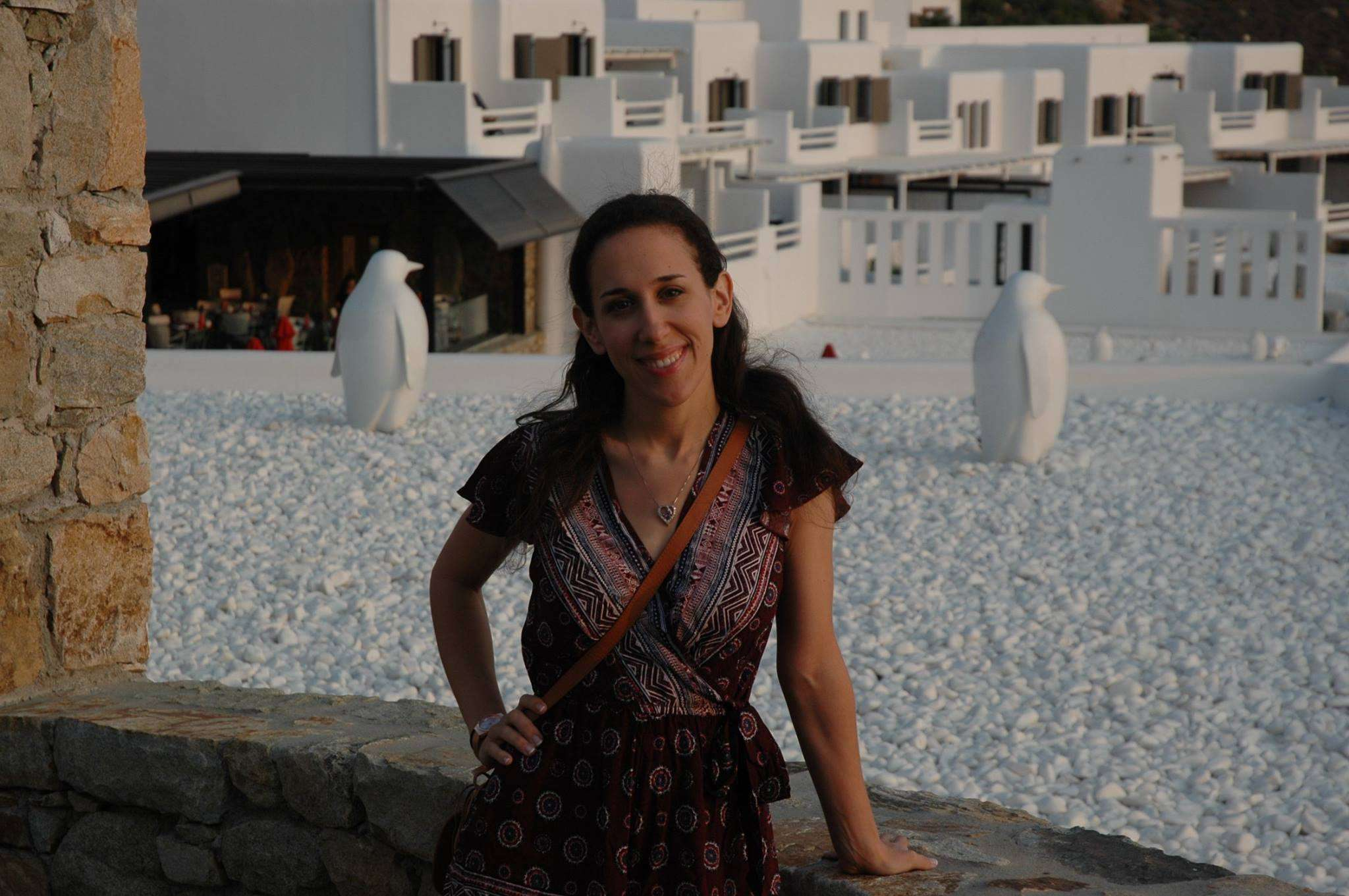 Posing with the penguin statues at the Myconian Avaton Resort