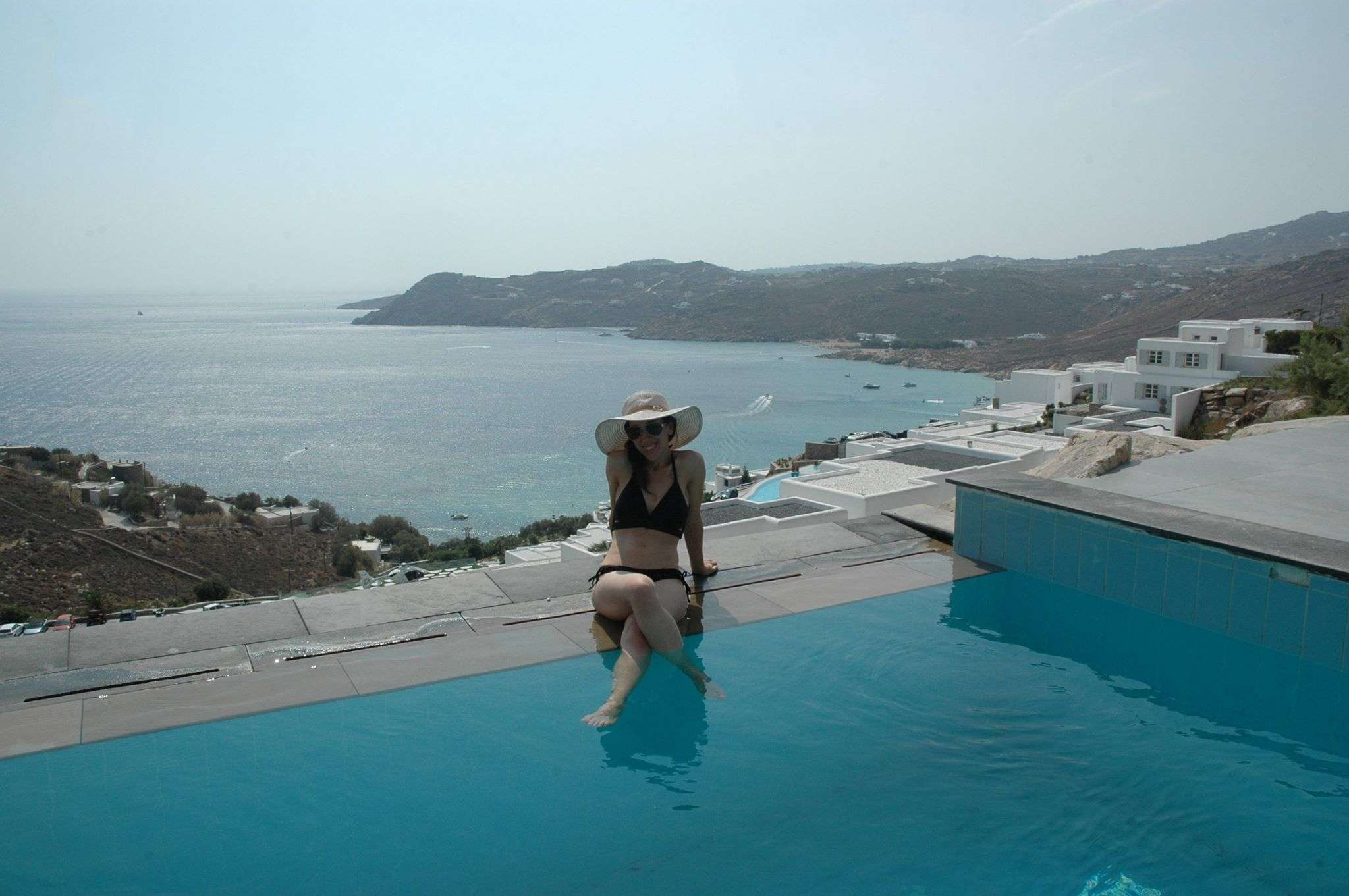 Lounging by our private infinity pool at the Myconian Avaton Resort in Mykonos