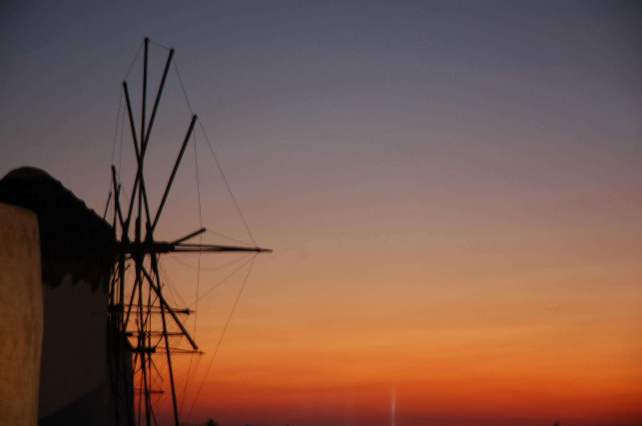 A Mykonos windmill at sunset