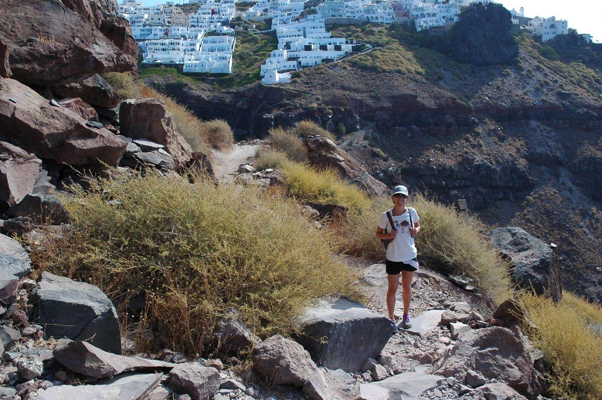 Hiking up Skaros Rock in Imerovigli, Santorini