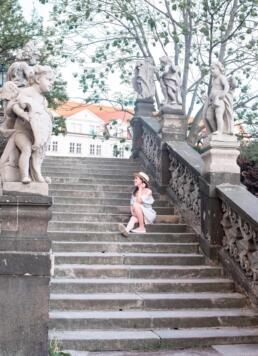 Sitting on a stairway near Novy Svet in Prague