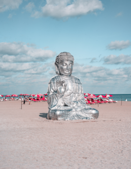 Buddha beach statue behind Faena, Miami