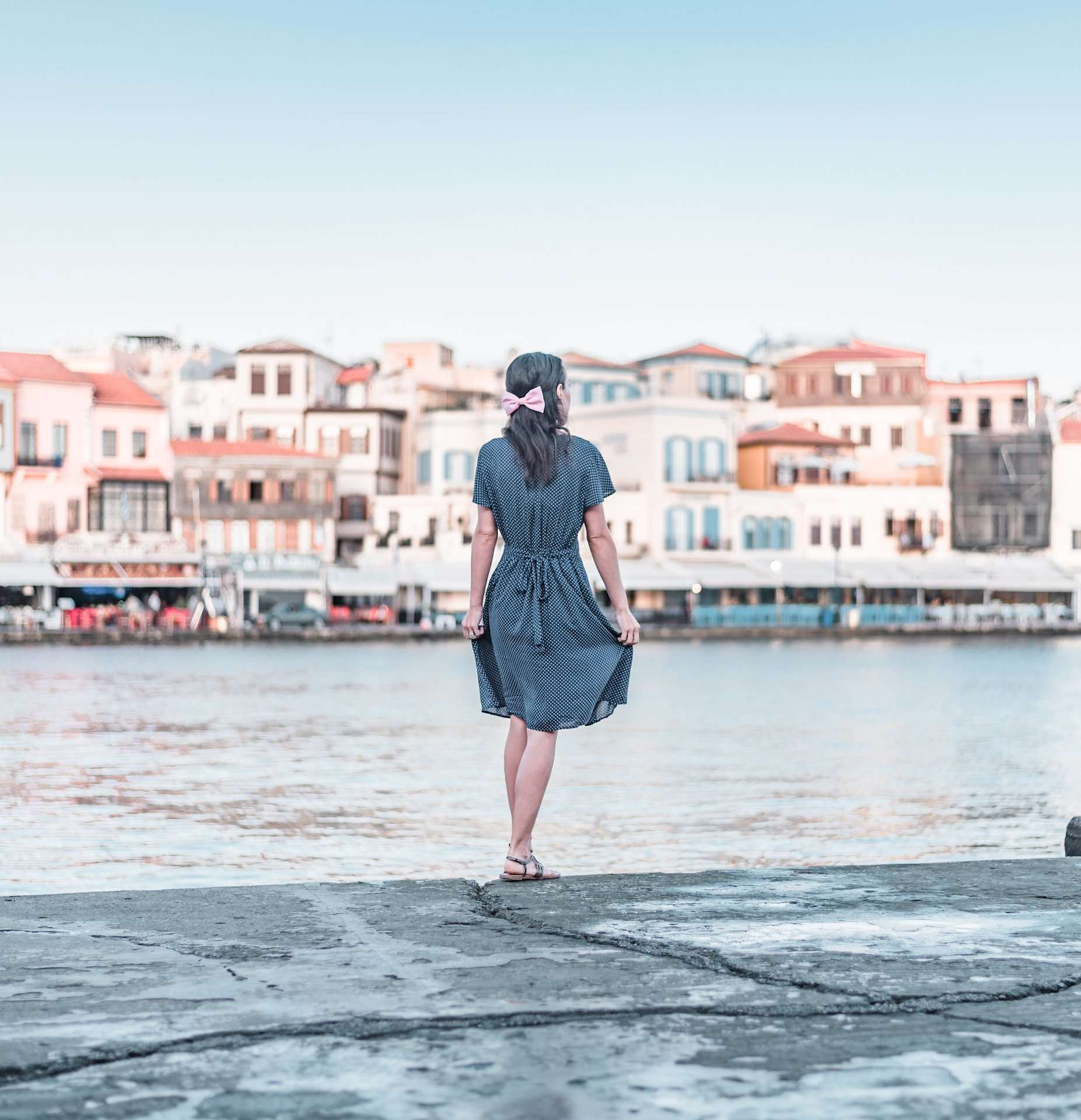 Standing along the Venetian Harbor in Chania, Crete