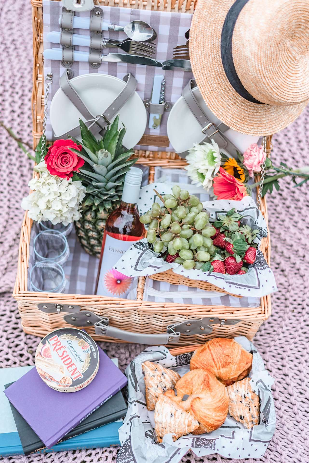 picnic basket with fruit, wine, and bread