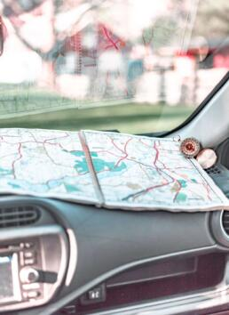 Map and compass for a road trip
