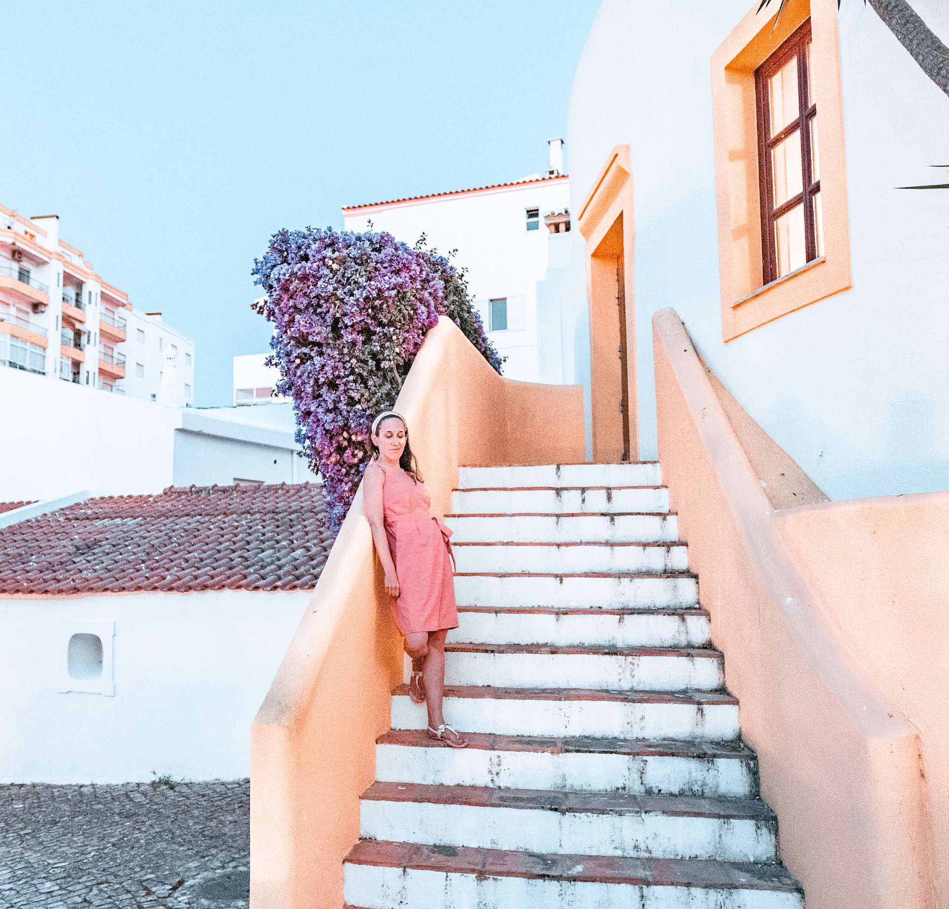 standing on a yellow staircase in Lagos, Portugal