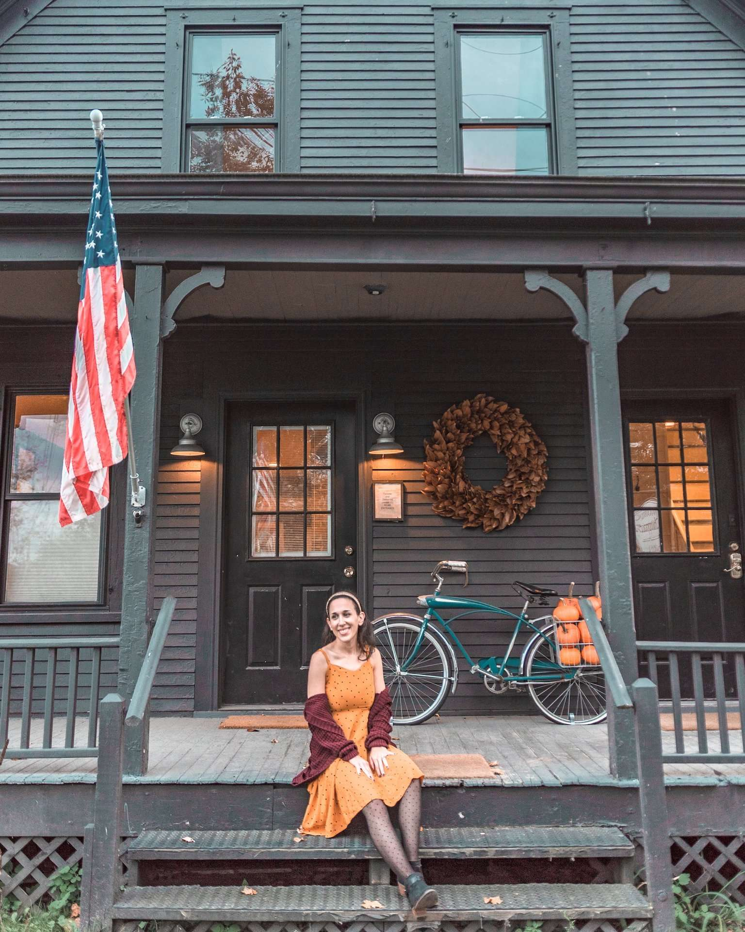 festive fall stoop with pumpkins in a bicycle basket