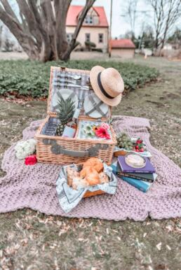 pretty picnic basket open on blanket