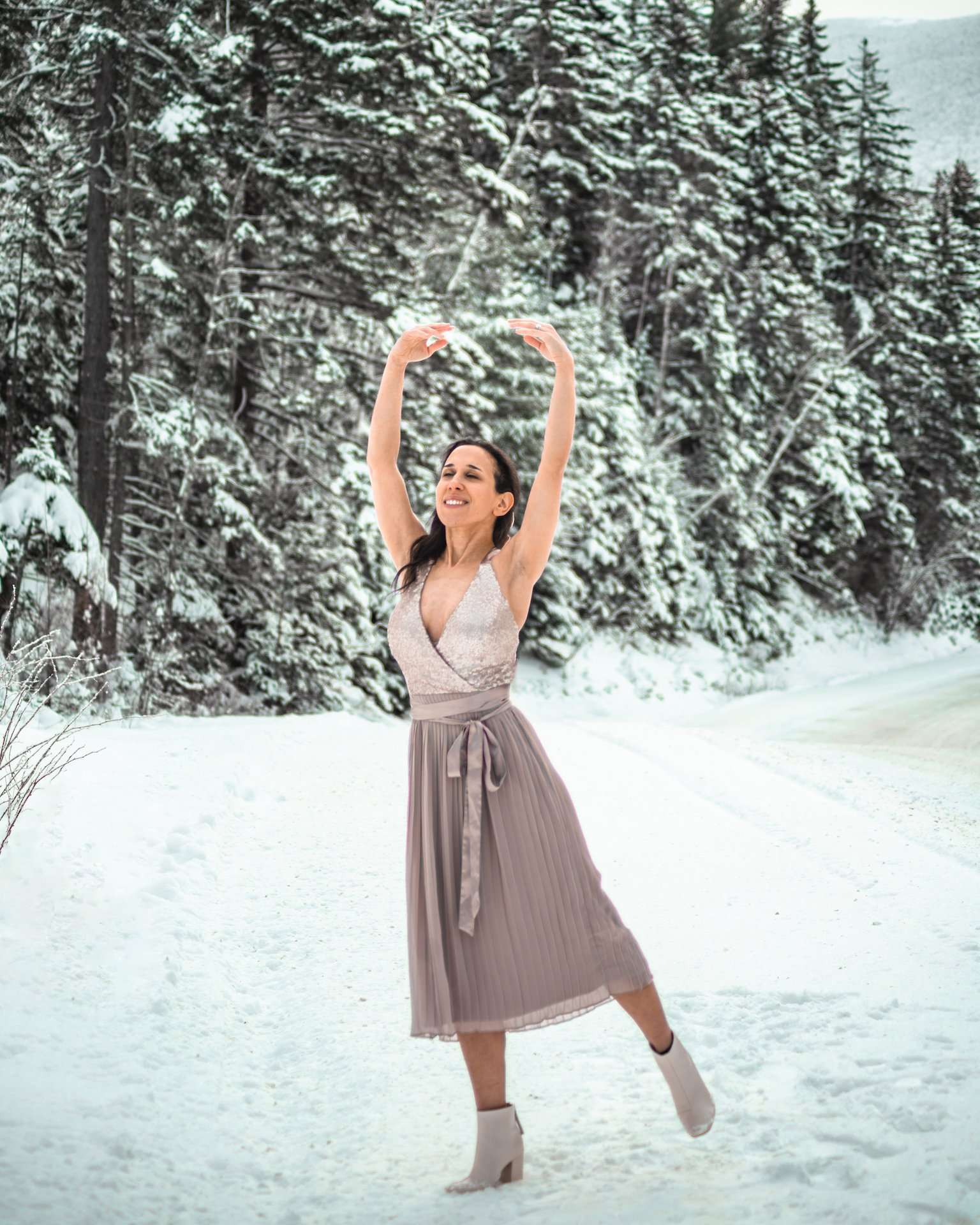 girl in dress dancing in snow