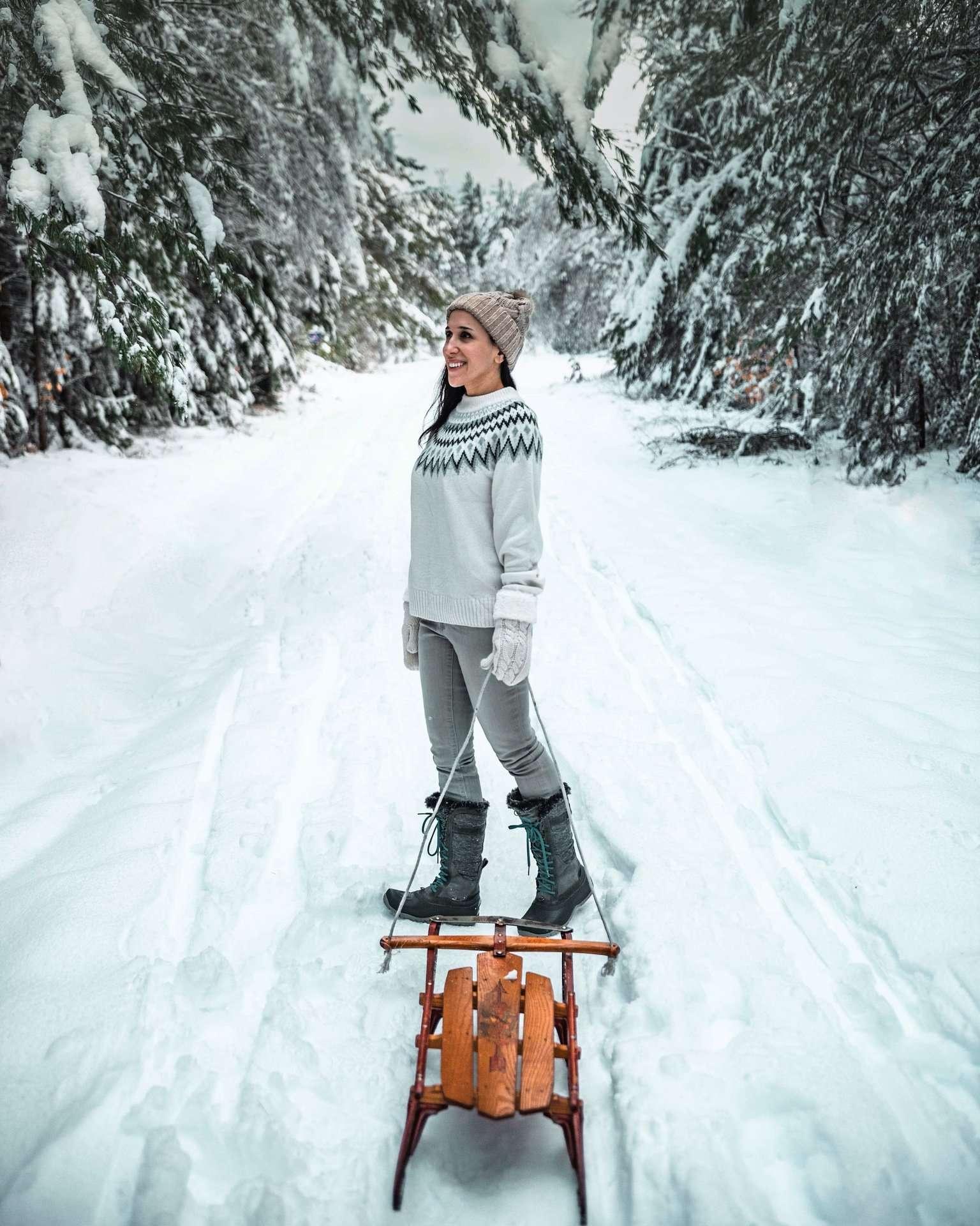 girl sledding in snow