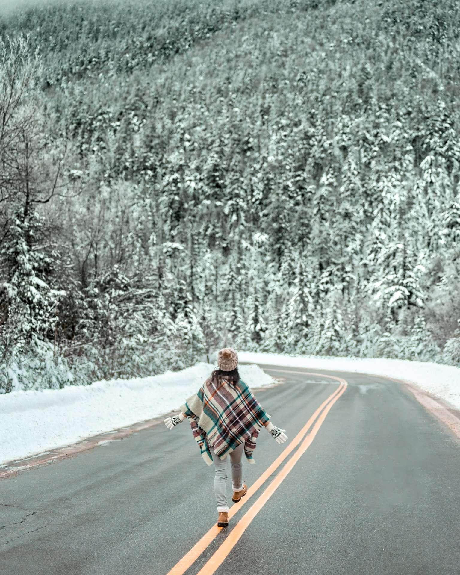 girl walking snowy highway