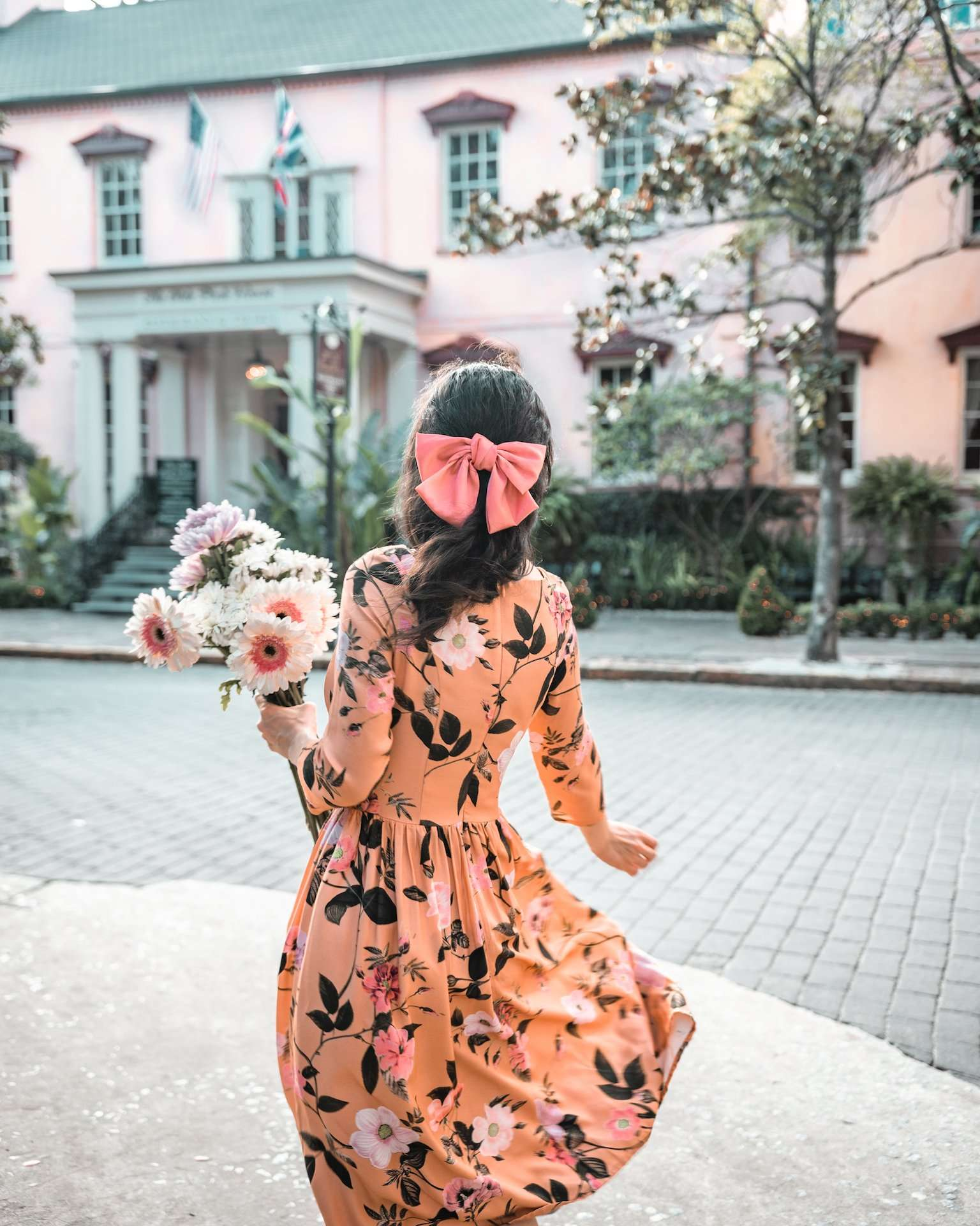 girl in floral dress at the Olde Pink House, Savannah