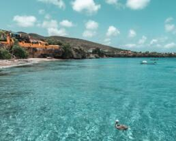 Is a tropical vacation to the Caribbean islands calling your name? Then consider an escape to Curacao to experience the wonders of island life. From colorful Colonial buildings, to unspoiled natural treasures, to stunning Curacao beaches, this guide of the 20 best things to do in Curacao will inspire an unforgettable Curacao vacation. Discover the exciting Curacao excursions that await you in this Dutch Caribbean paradise! #curacaoisland #curacaonationalpark #curacaonature #curacaotravelguide